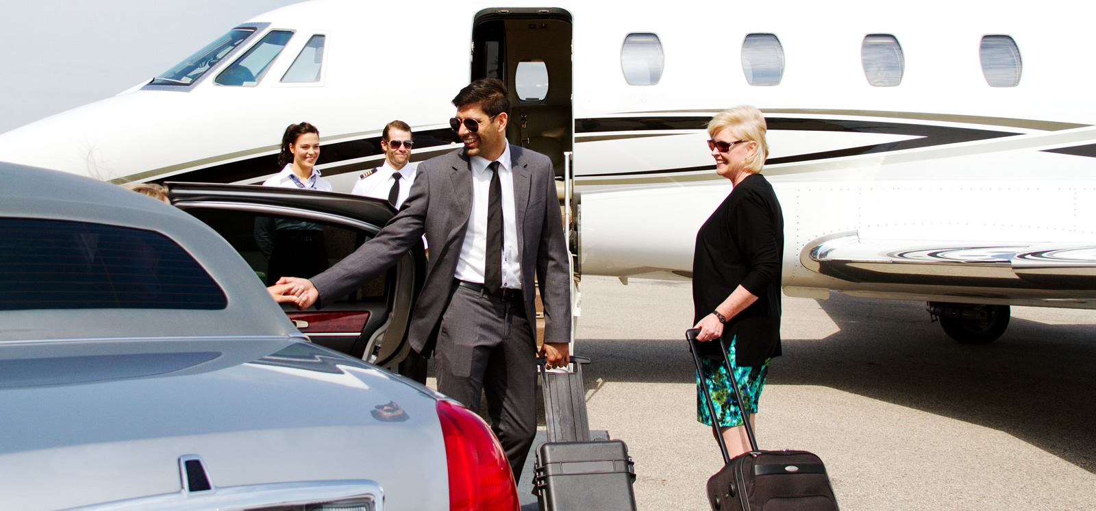 High Profile Individual Leaving His Chauffeur To Board A Private Jet, With Security Personnel Present
